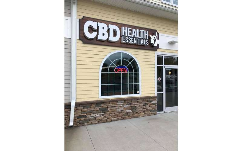 entrance sign of a cbd health essentials store