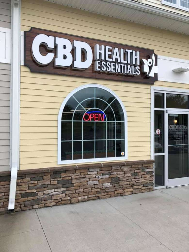 entrance sign of a cbd health essentials store