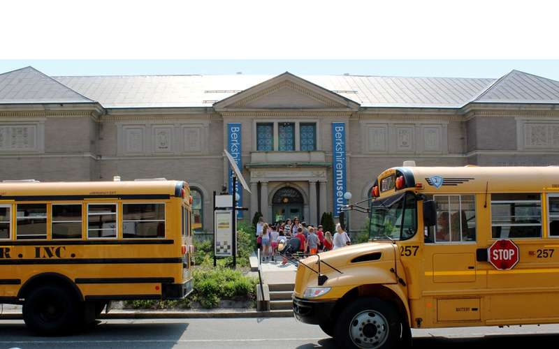 school buses outside a museum