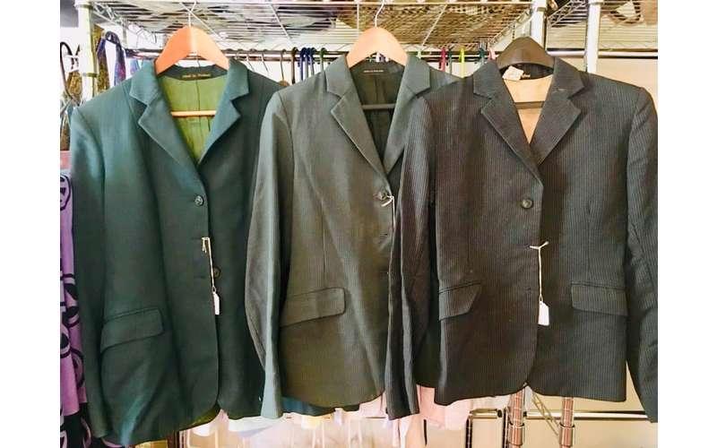three coats on hangers