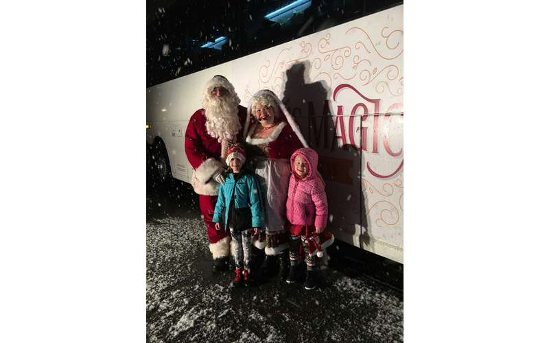 santa and mrs claus and two kids
