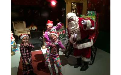 santa claus and three kids