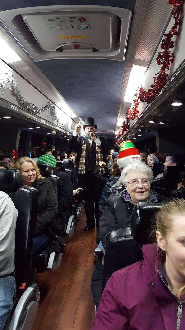 people on a holiday bus ride