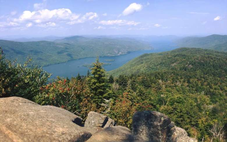 view from rocky overlook of forest and lake