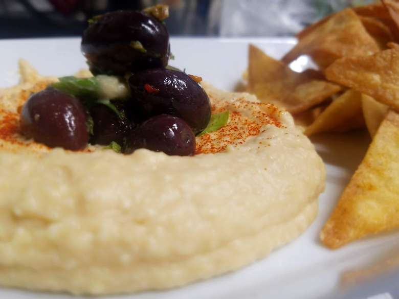 hummus with olives on top