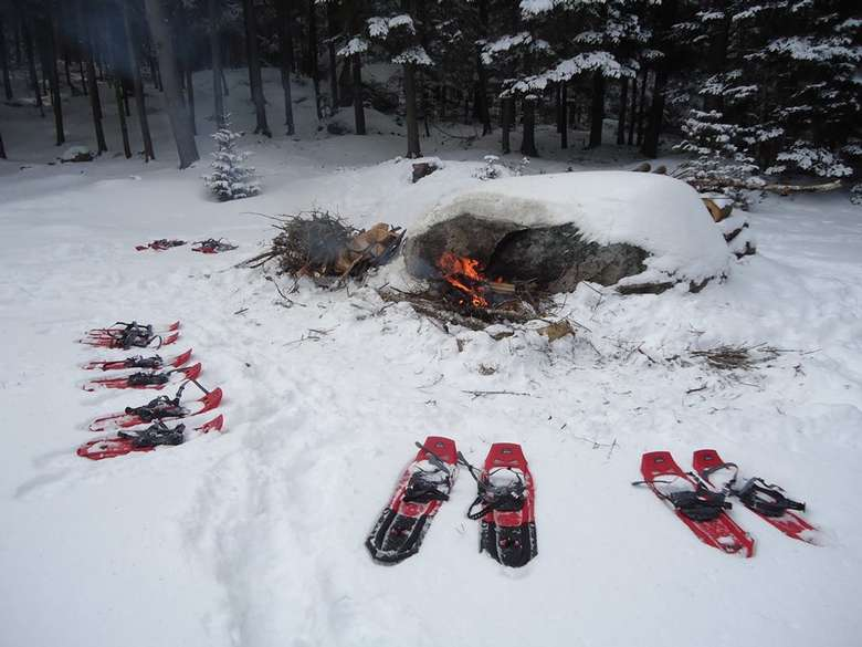 pairs of snowshoes around a fireplace
