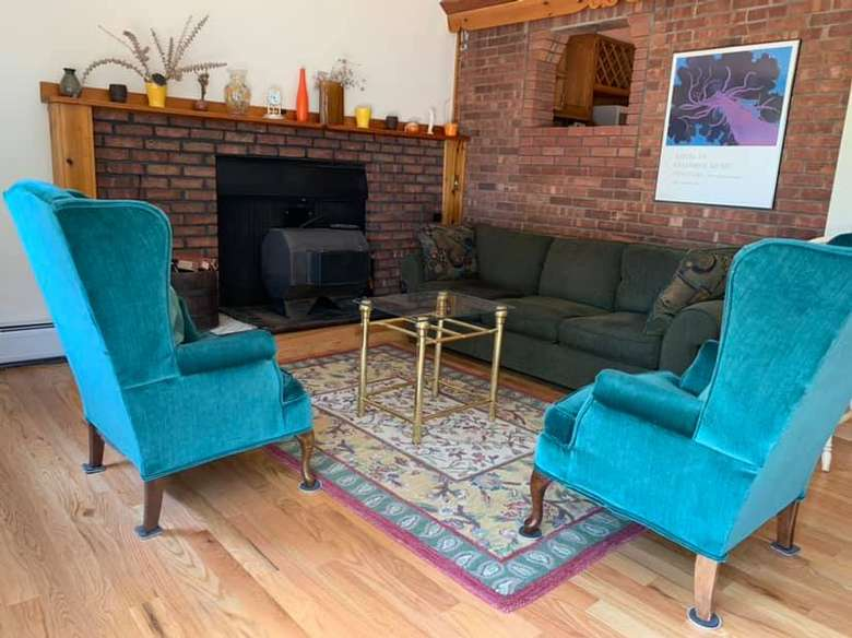 two bright blue chairs in a living room