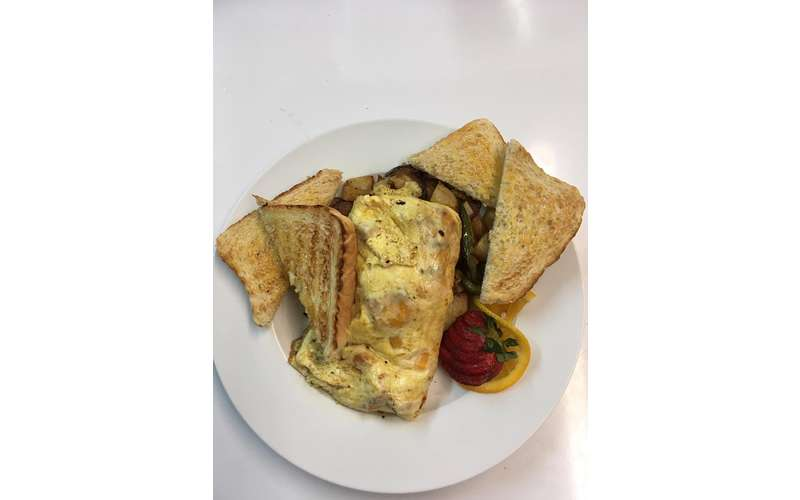 egg omelet with hash and toast