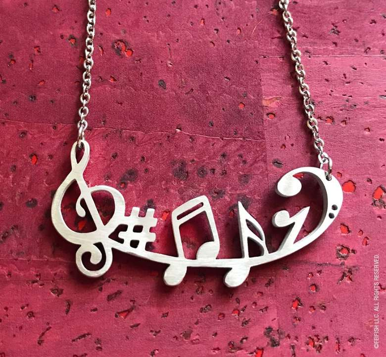 steel necklace with music note design
