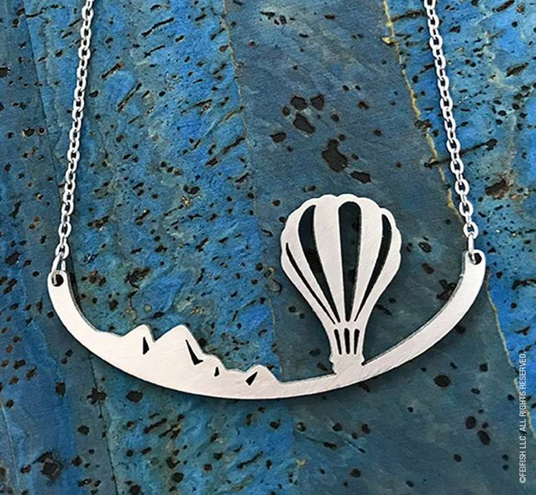 steel necklace with hot air balloon design