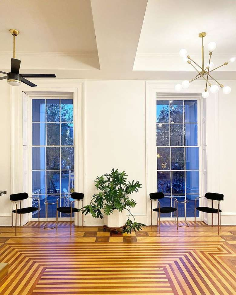 chairs positioned near tall windows