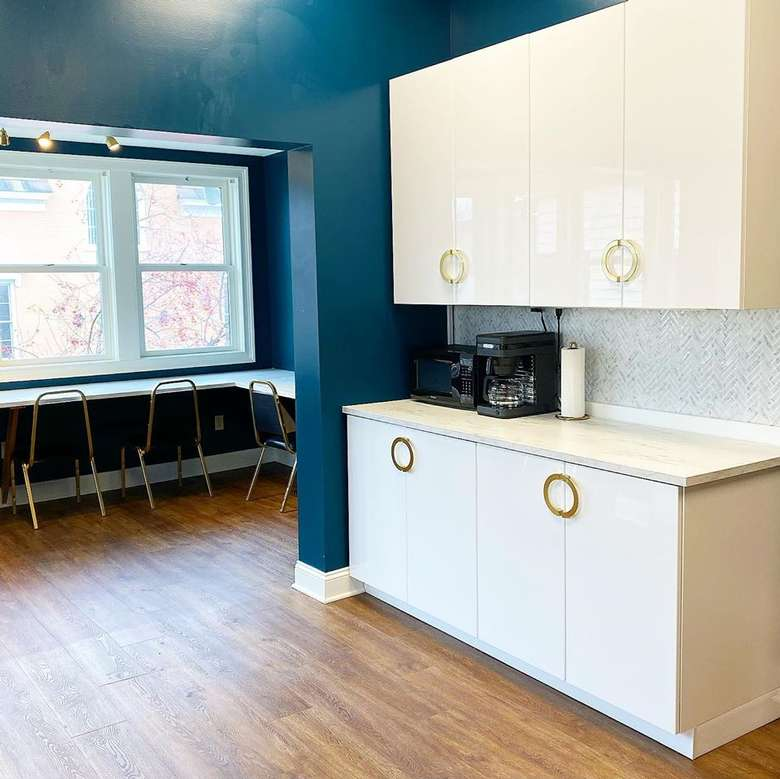 small kitchen area with coffee maker and microwave