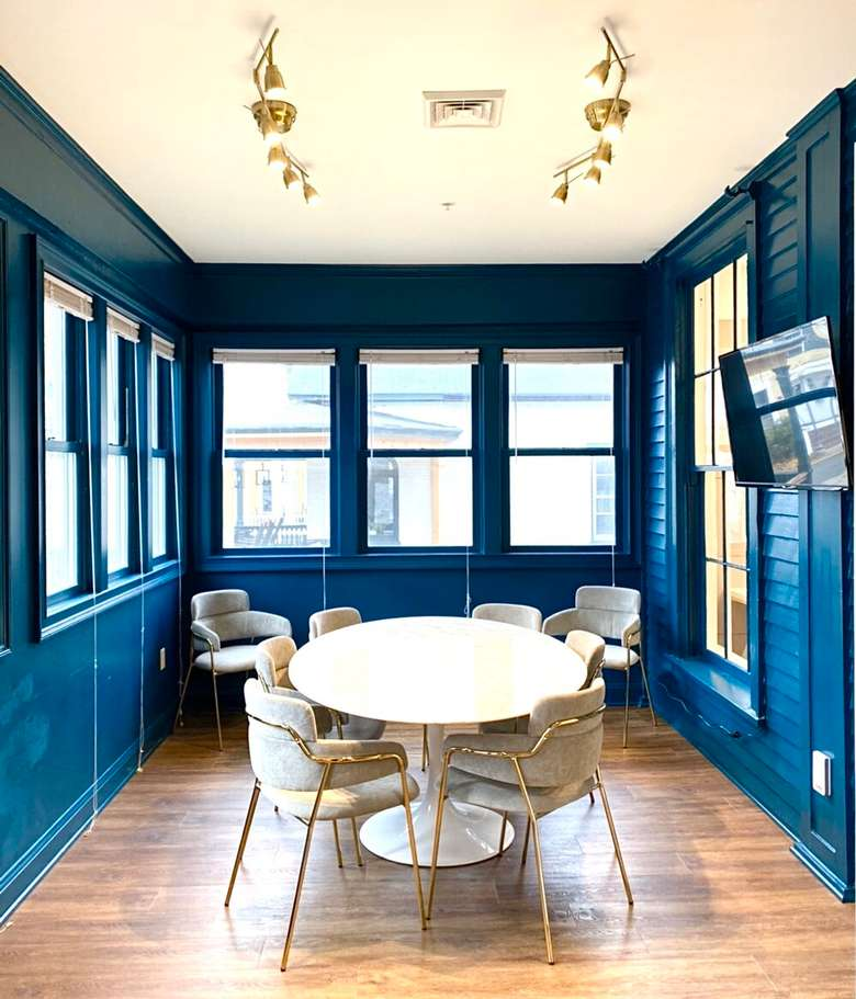 round table in a room with blue walls and windows