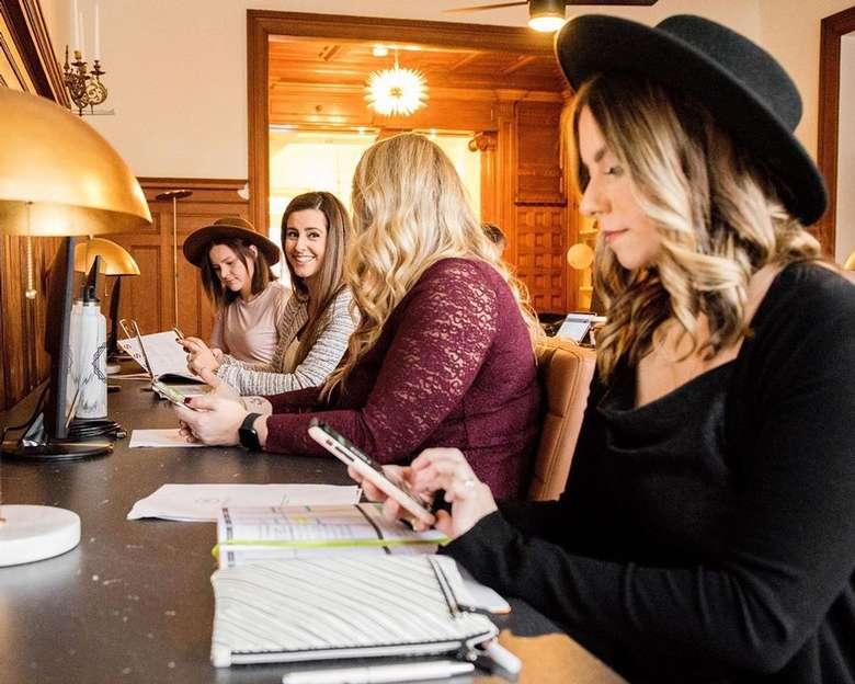 four women at a desk