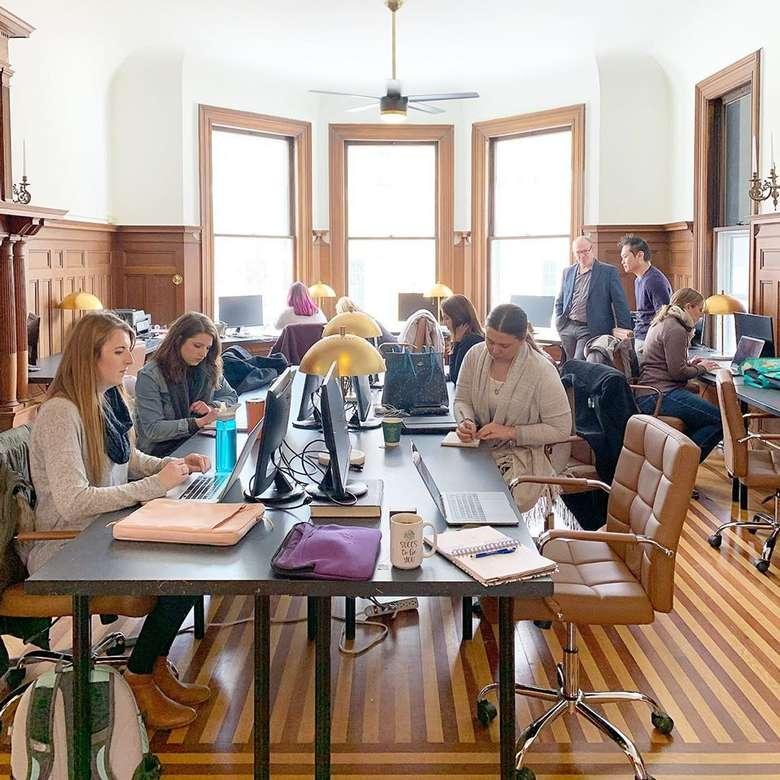 people at desks in a room