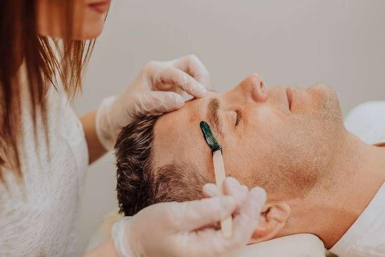 man receiving a skin treatment