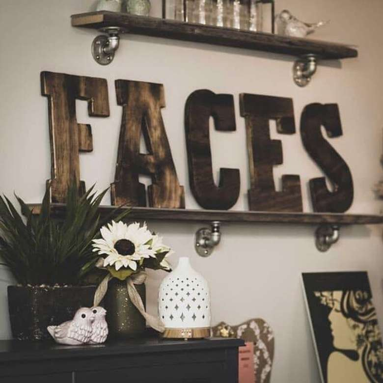 letters on shelf that spell faces