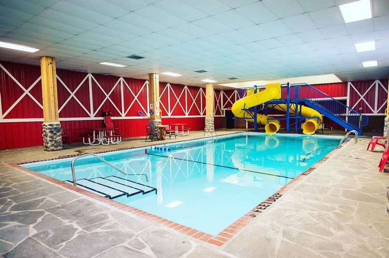 indoor swimming pool with yellow slides at one end