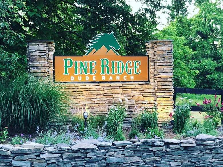 entrance sign for pine ridge dude ranch