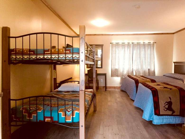 room with bunk beds and separate beds