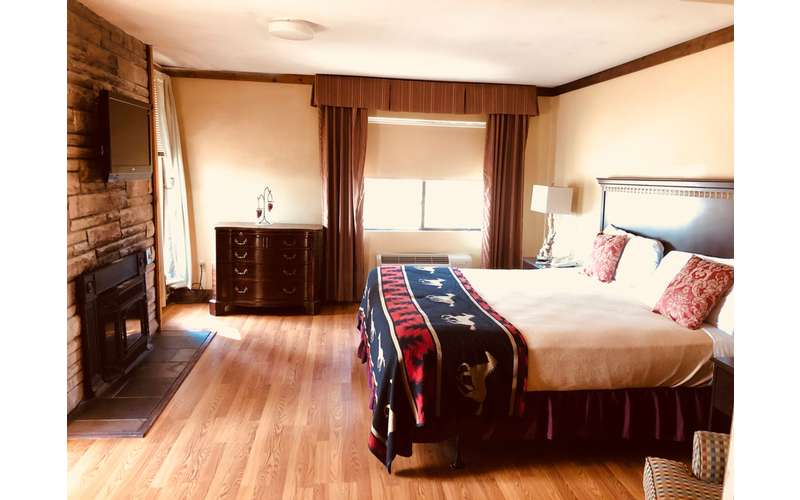 bed in a room with a wooden floor
