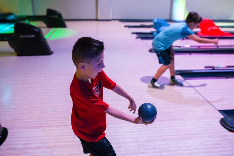boy with candlepin bowling ball