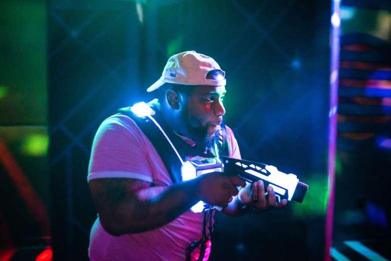 man doing laser tag