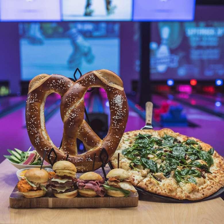 big pretzel, pizza, and sliders