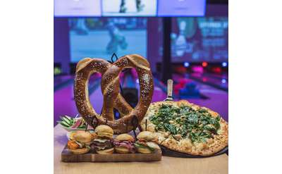big pretzel, pizza, and sliders
