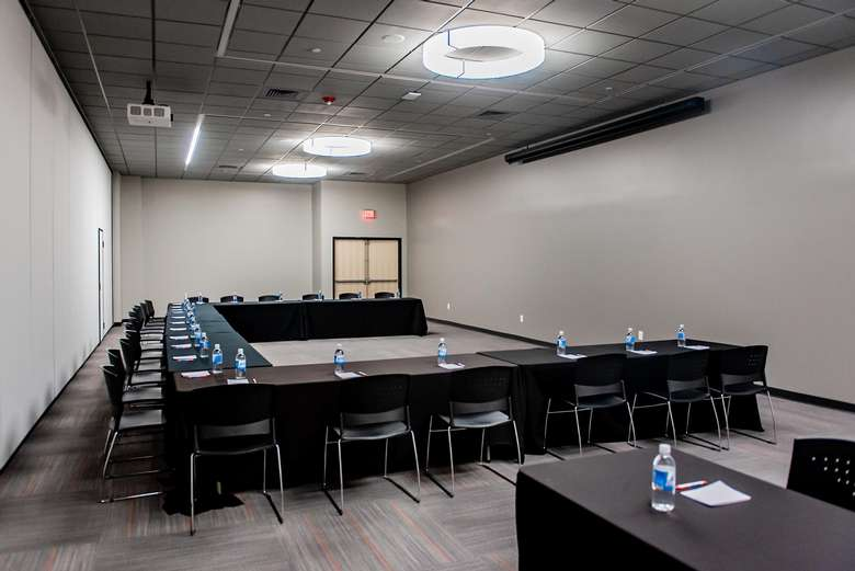meeting room tables with bottles of water on them