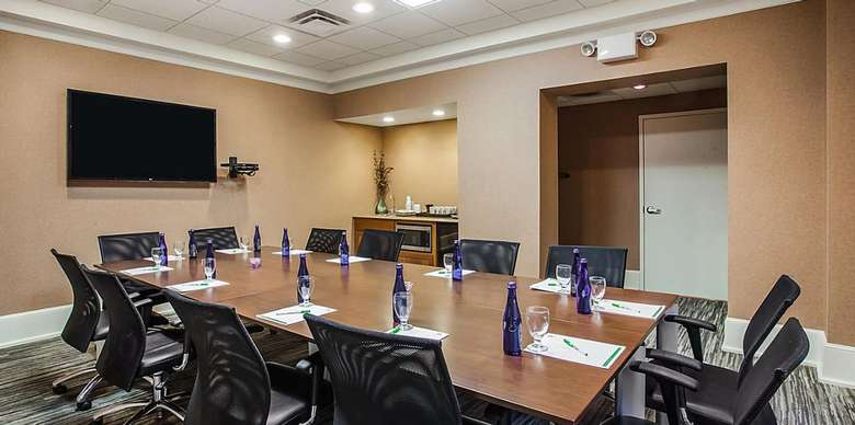 meeting room with a rectangular table with chairs around it