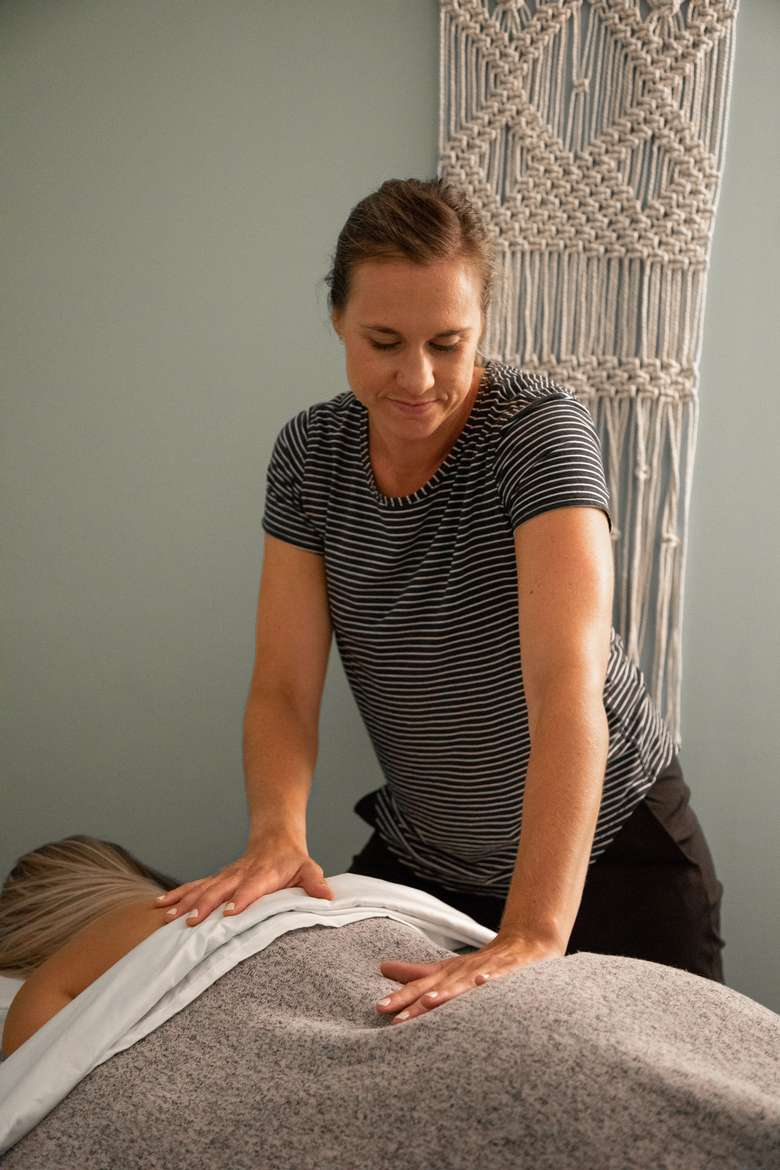 woman giving massage to back