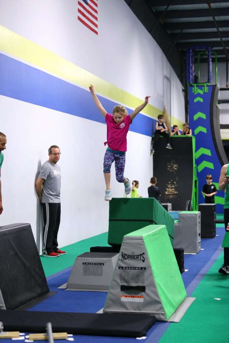 girl jumping off block in a gym