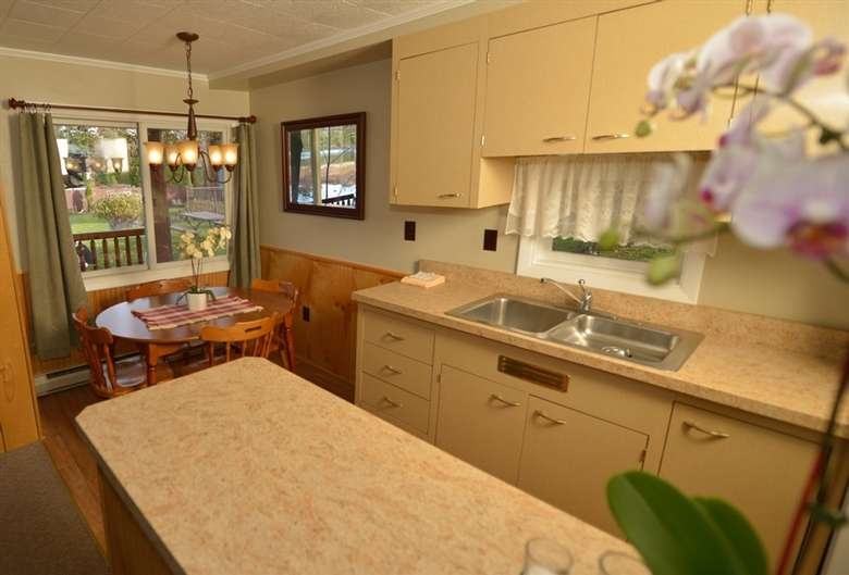kitchen area with a round dining table nearby
