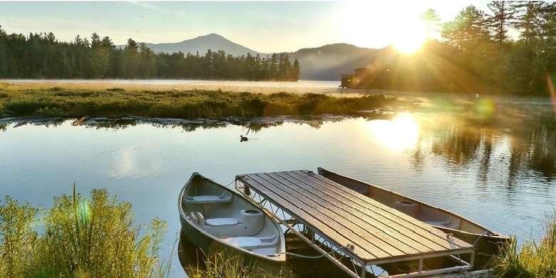 boat dock with canoe by it
