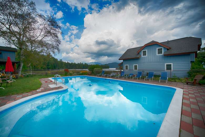 outdoor pool near blue house