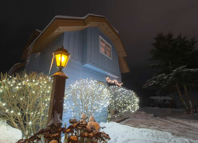 cottage at night in snow