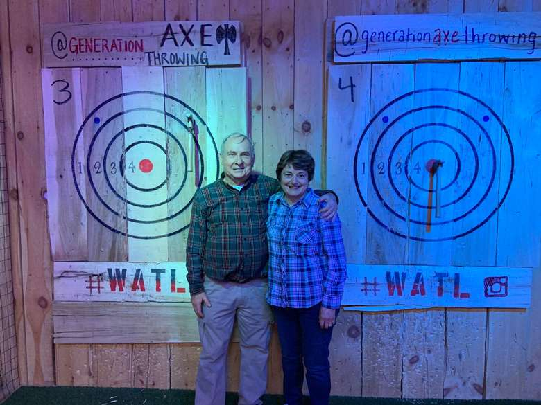 couple standing by targets