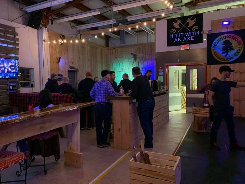people at axe throwing place