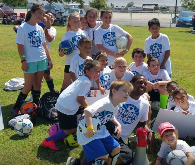 group of soccer kids posing for a photo
