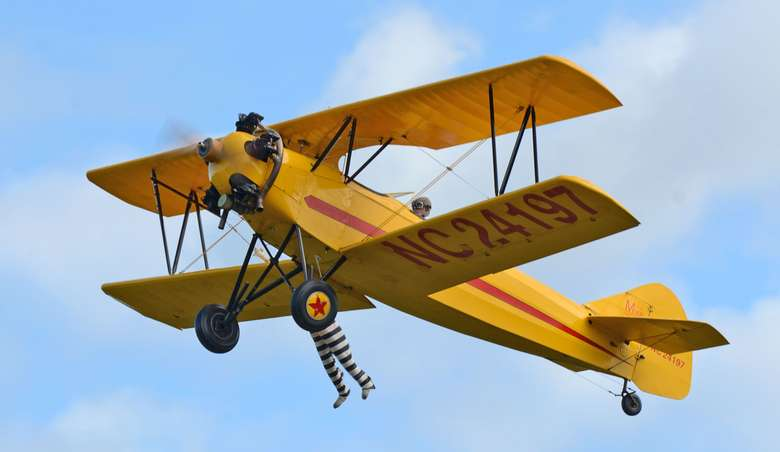 a yellow airplane in flight