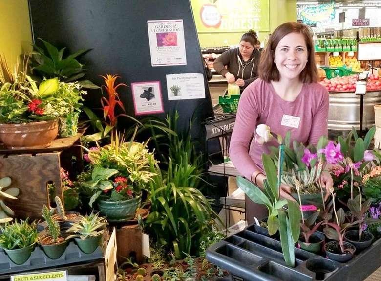 women standing near plants in a store