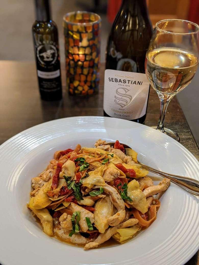 pasta and chicken dish, wine