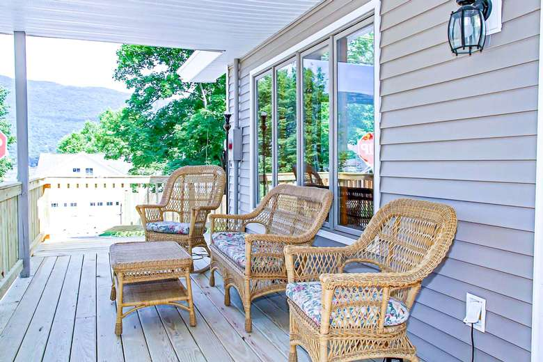 wicker chairs and bench on an outdoor deck