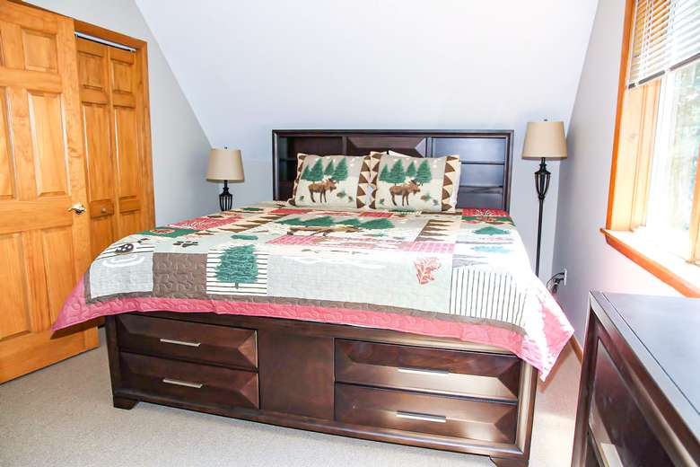 bed with adirondack themed covers