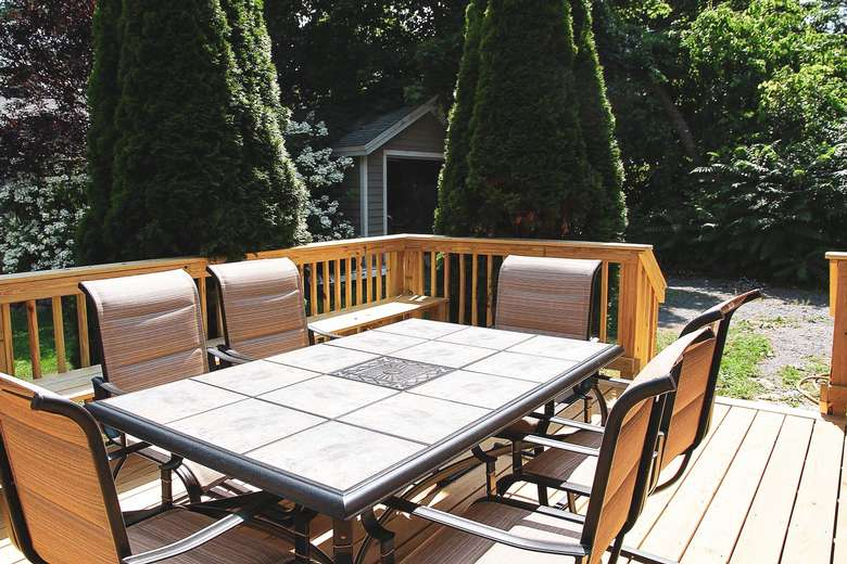 table with chairs on an outdoor deck