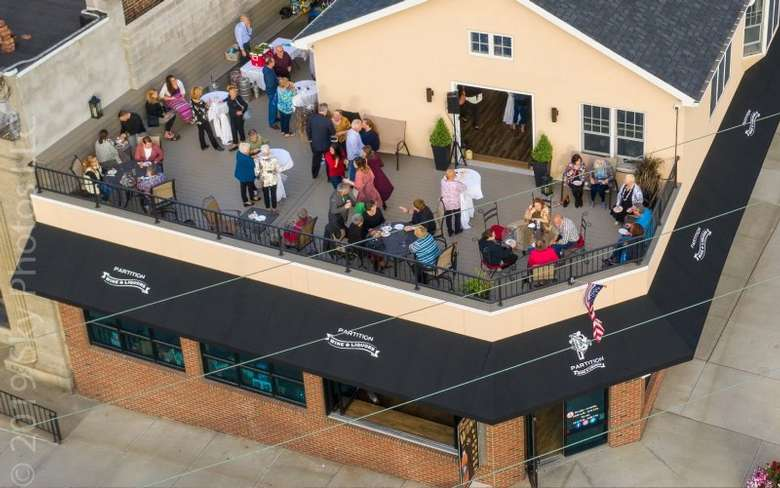 aerial view of people on a rooftop patio