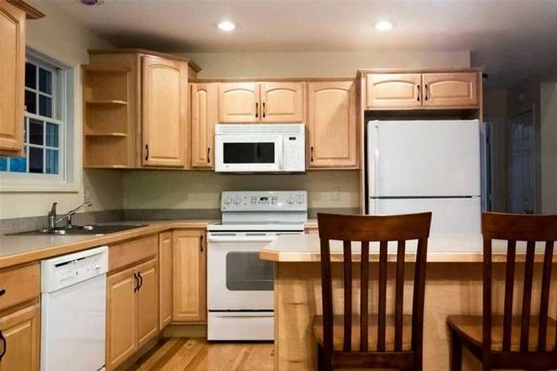 a clean kitchen with appliances and cabinets