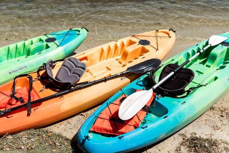three kayaks on a beach