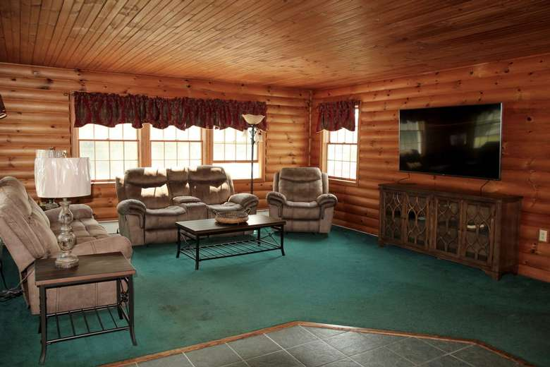 rustic living room with furniture and tv